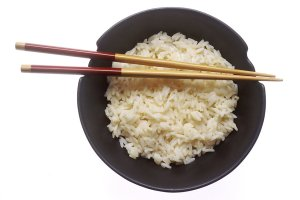 17321-a-bowl-of-rice-with-chopsticks-pv